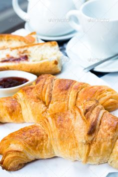 coffee and croissants ...  bake, bakery, beverage, bread, break, breakfast, bun, butter, buttered, buttery, cafe, caffeine, coffee, croissant, cuisine, cup, drink, eating, espresso, food, french, freshness, golden, heat, hot, life, mocha, morning, object, pastry, roll, saucer, snack, still, sugar, traditionally