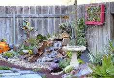 This small space garden includes pond less waterfall, seating areas, flagstone paths, raised vegetable bed, succulent vertical art and more! Designer/Laura Eubanks at Design for Serenity Landscape Design, Garden Design, Flagstone Path, Small Ponds, Water Features In The Garden, Small Space Gardening, Outdoor Living, Outdoor Decor, Planting Succulents