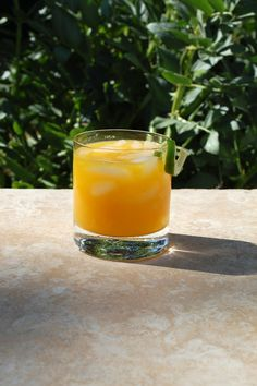 Mango Margarita  (makes one drink)    Ingredients:        3 oz mango puree, approximately one mango      1 1/2 oz tequila      1/4 oz cointreau or triple sec      1 oz orange juice, freshly squeezed      1/4-1/3 oz lime juice, freshly squeezed      Ice      Lime twist for garnish