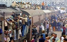 Indian Train, or a train of necessity. [Wow. Makes me wonder how fast this train went and if the people on top stayed on it.]