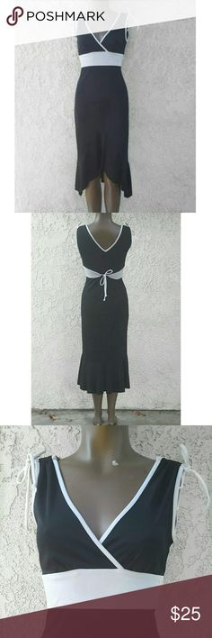 Hourglass  Black and White Dress Size Small  New without Tag  Adjustable Tie Back to Adjust to your Waist  White Ties on the Shoulders Hourglass  Dresses