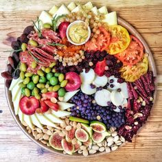 These cheese plates from the Cheesemongers of Santa Fe are the most beautiful things I've ever seen. Bon Appetit! Photo and cheese plate by ©2015 Lilith Spencer).