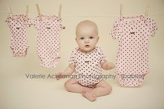 Buy the same onesie and do a 3, 6, 9, and 12 mos. soo cute!