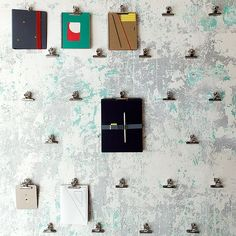 Close up of a bulldog clip wall display. Papelote, New Czech Stationery / A1Architects