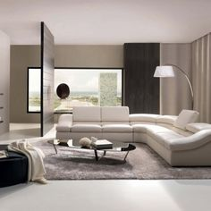 Furniture : Gorgeous white upholstered l shaped sofa with adjustable headrest for apartment design come and grey furry rug also oval black glass table feature steel frame plus round black velvet ottoman - Small Apartment with Sofa Design Collection