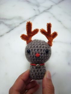 Tiny amigurumi reindeer plush or ornament