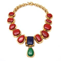 Signed YSL Rive Gauche collar necklace with large red, green and blue cabochons set in artisanal gold-toned metal. With double rolo chain, heart-shaped link on clasp, and YSL stamp on the back of each link. Contemporary. By Carole Tanenbaum