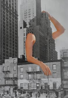 Melissa Plummer- Emphasis on the arms using color. Also, the placement of arms on a building is out of the ordinary which draws the viewers attention