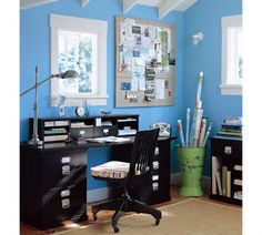 Love the blue walls in this home office
