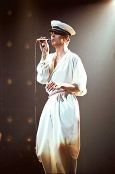 August 28, 1978 - Donning the linen look onstage in London during 1978. Admiral Halsey on top (??), monk below. A unique vision to go with the sound at London's Earl's Court.