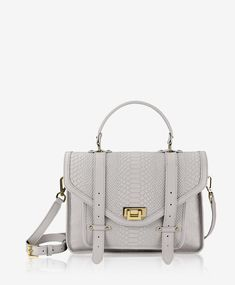 Leather flap front satchel bag with metal fold-over closure and leather  pull-tab straps and exterior back slip pocket. Dual carrying options  include top ... a081bb06b27d3