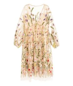 This H&M dress has become a fashion favourite for spring/summer, featuring a floral mesh design and statement sleeves. Click for info!