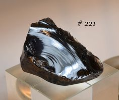 Big, Glassy, Beautiful Obsidian Cobble, with Great Vitreous Conchoidal Fracture Surface by JonesMineralCabinet on Etsy https://www.etsy.com/listing/239399772/big-glassy-beautiful-obsidian-cobble