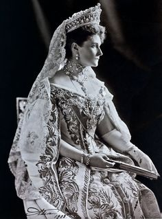Tsarina Alexandra wearing Russian court dress and diamond chain of the order of St Andrew