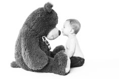 6 month old baby boy pictures.  Staring contest with his big teddy bear - Carlo Vivenzio Photography