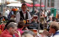 The Markt in Bruges is a popular place to eat and drink for tourists, though locals tend to avoid it