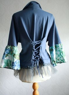 I wonder if you could do this to any old oversized/outgrown sweater or jacket? Hmmm.....