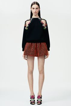 Christopher Kane | Resort 2015 | 30 Black cut out floral long sleeve sweatshirt and orange embroidered mini skirt