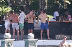 Prince Harry Photos Photos - Prince Harry is spotted at a beach in Jamaica on March 4, 2017 with friends. Harry and girlfriend Meghan Markle were on vacation attending a friends wedding. - Prince Harry Relaxes on the Beach in Jamaica With Friends