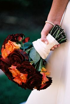 orange and burgundy wedding bouquet photo by Yvette Roman Photography