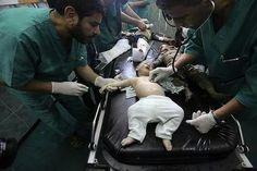 Three children on on bed (just in Gaza )..