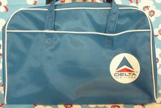 We go back in time and look at old-school airline carry-on bags.: Delta Air Lines