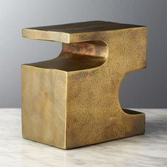 Shop Esher Antique Brass Bookend.   Metal block makes a modern statement inspired by one of our favorite abstract artists.  Crafted of cast aluminum with antique brass finish, piece stands its ground as bookend or objet d'art.