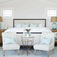 This home's designer, Becky Owens, made a cozy nook at the foot of the bed with two tufted chairs. D... - Lisa Romerein