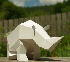 Paper Rhino Sculpture by Paperwolf. Rhino is very tired, needs to rest for a while.