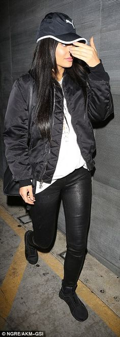 Stylish display: Continuing the sporty feel of the look - and also showcasing her love for the Puma label - the reality star sported a baseball cap by the brand atop her head, a black bomber jacket finishing the style