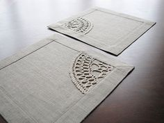 Set of 4 square table napkins from natural color linen fabric with crocheted linen yarn applique. Handmade. Very versatile size: mini placemat or maxi coaster. Double, with mitered corners classic border (3 cm.) Aplique stitched by sewing machine. Perfect gift. Square 9 2/4 (24 cm.) *pure natural linen color (linen grey) fabric. *pure natural linen yarn. *delicate machine or hand wash. The colors of the item may vary slightly due to different computer monitor settings. ONLY ONE SET O...
