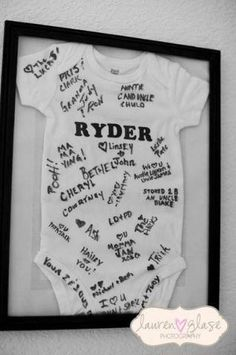"Definitely doing this with the next little one! Have friends and family sign a onesie at the hospital and frame as a ""guest book"""