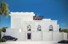 White stone with geometric patterns adorn the modern Islamic villa exterior façade by Comelite Architecture Structure and Interior Design, double height horseshoe arch create a welcoming entryway, and pointed arched windows integrated with modern building lines seamlessly blend the modern with traditional Islamic styles.