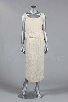 A beaded ivory silk crepe evening gown, circa 1922