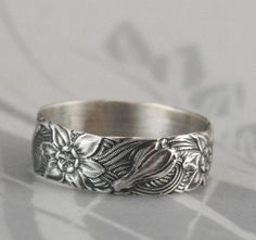 Vintage Style Band--Signs of Spring--Silver Wedding Band--Crocus Ring--Wide Silver Band--Floral Patterned Ring--Daffodil Ring--Daffodil Band by debblazer on Etsy https://www.etsy.com/uk/listing/70506733/vintage-style-band-signs-of-spring