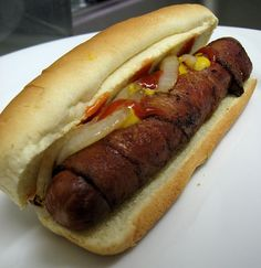 Bacon Wrapped HotDogs.  They taste even better when cooked over an open fire.