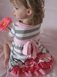 Oh my adorable!  Repurposed t-shirt dress with ruffles in the back.  Slightly more difficult than others, but pretty much the cutest thing I've ever seen