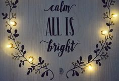 All Is Calm All Is Bright is hand-painted in black surrounded by a lit wreath with metallic gold berries on a whitewashed pine background.  This item measures measures 20 x 14  Includes battery powered warm white LED lights with white wire. 3 AA Batteries are not included.  This item does not include hanging equipment.   Hand-painted. No vinyl.