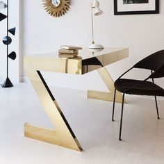 Black and Gold luxury modern office | Find more luxury unique desks for your office in www.bocadolobo.co… #luxuryoffice