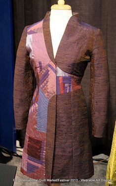 Here is a sampling of the many wonderful works of wearable art that was on display at the Fall International Quilt Market/Festival 2013 in Houston, TX. Michael snapped these photos last month as he wandered through the immense gallery of quilts and related textile arts.  Enjoy!