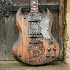 One could make some epic Viking metal with this beast!  Check out the creator: Hutchinson Guitar Concepts