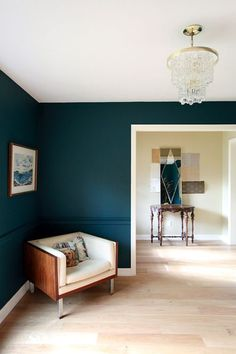 This would be amazing for the basement! Site says its Benjamin Moore Dark Harbor Paint mixed 25% darker. Previous pinner said: tried River Blue (very similar) and its too dark for my small space. Galapagos Turquoise is the next lightest shade on the swatch card. [the white trim and light floor make it awesome]