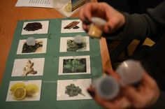 Deborah Rothenberg explains the use of photos and small bottles of spices that are used to help participants with their memory and cognitive abilities as part of an activity at the Dementia Support Dov & Zipora Burstein Senior Centre in Toronto. (Fred Lum/The Globe and Mail)