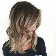 Most examples of balayage on the Internet feature long hair. But shoulder-length locks also look very beautiful with ombre and with balayage. Brunettes who want to lighten up their hair significantly may go this cute idea with a light brown tone around the face, dark blonde at the ends and a sprinkling of the lightest blonde throughout the length.