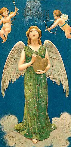angel holding gold heart.