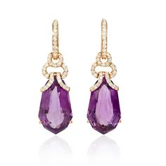 These fantastic 18k rose gold dangle earrings, feature 2 purple amethyst stones, weighing 25.29 carats total with 74 round brilliant cut white diamonds of F color, VS2 clarity, of excellent cut and brilliance, weighing .95 carat total.