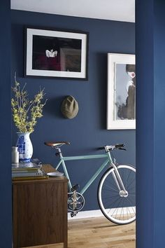 neat but impressive dark blue hallway displays a distinctive Kathrin Baumbach print, a contrasting Rob Ryan vase bought in Article as well as the sweet-looking townbike from On Track fixed-gear specialists in Dublin Dark Blue Hallway, Dark Blue Walls, Blue Hallway Paint, Long Hallway, Mood Board Inspiration, Hallway Inspiration, Hallway Colours, Room Colors, Hallway Displays