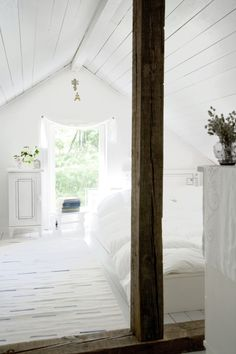 I love an all white room.... I just know it isn't practical for my family