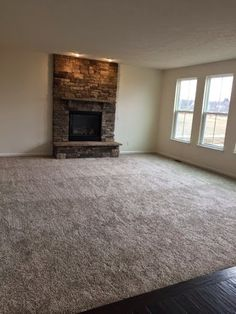 The floor to ceiling rock for the fire place is an option you pay extra for. Honestly I'd pay extra not to have it. Imagine dusting that thing! Good heavens!