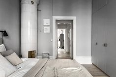 A modest grey home with a perfect mix of textures and materials. I like the beige layers of bedding against the soft grey wall in the bedroom and the low wooden tv bench in particular. via Alexander White Scandi Home, Scandinavian Apartment, Cozy Bedroom, Bedroom Decor, Home Interior, Interior Decorating, Decorating Ideas, Small Home Offices, Gravity Home